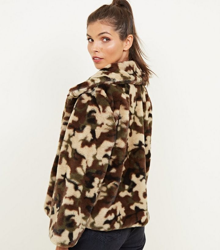 f26bc206b3ee ... Mela Green Camo Faux Fur Jacket. ×. ×. ×. Shop the look