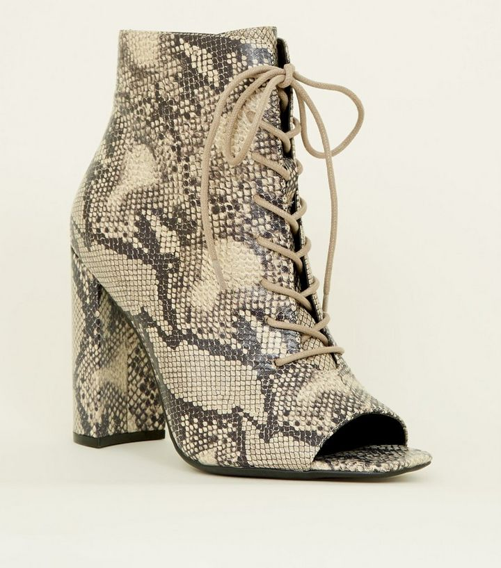 67d0b56cc90 Stone Faux Snake Lace Up Block Heels