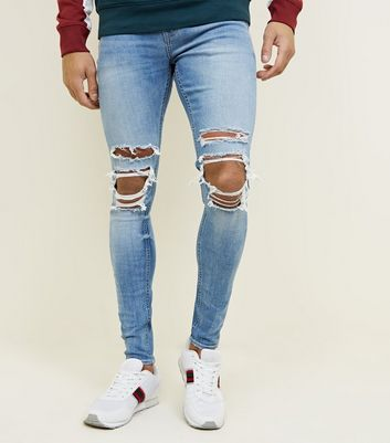 Pale Blue Ripped Knee Spray On Jeans