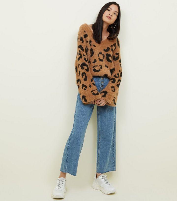 f5fa34d31f45 ... Brauner, flauschiger Pullover mit Leopardenmuster. ×. ×. ×. Hol dir den  Look