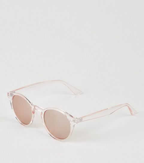 adc8ef9723f924 ... Lunettes de soleil rondes or rose à montures transparentes ...