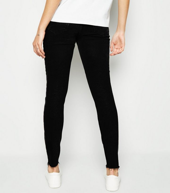 9d187e8cadbe3 ... Maternity Black Ripped Knee Over Bump Skinny Jeans. ×. ×. ×. Shop the  look