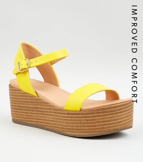 24ca482ebc54 ... Yellow Leather-Look Flatform Footbed Sandals ...