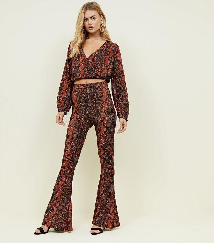 ae326d12b1dd Pink Vanilla Orange Snake Print Flared Trousers | New Look
