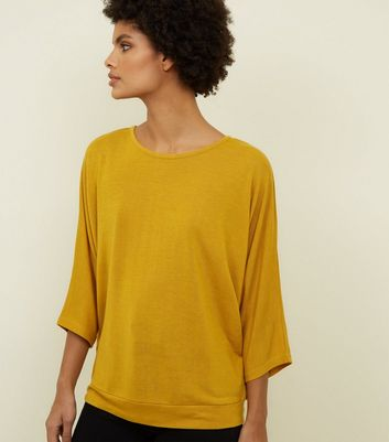 Mustard Button Back 3/4 Sleeve Top