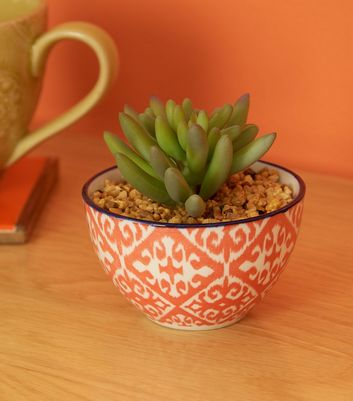 Orange Tile Print Bowl and Artificial Plant