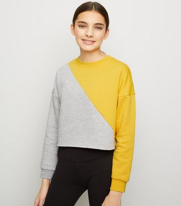 Girls - Sweat jaune design color block en diagonale