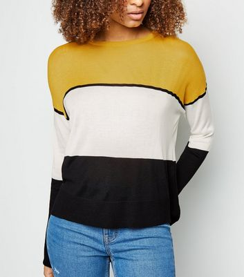 Pull jaune color block rayé en mailles fines