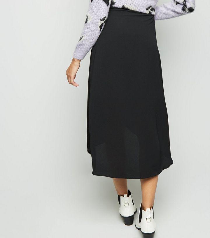 ce7de0c4e ... Black Crepe Midi Wrap Skirt. ×. ×. ×. Shop the look