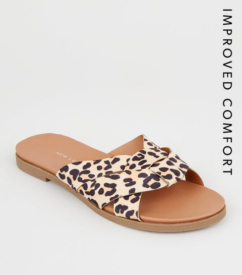 3050e3dc186 ... Wide Fit Stone Leopard Print Woven Footbed Sliders ...