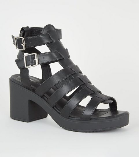 6ce485fd2e2e ... Black Leather-Look Chunky Gladiator Sandals ...