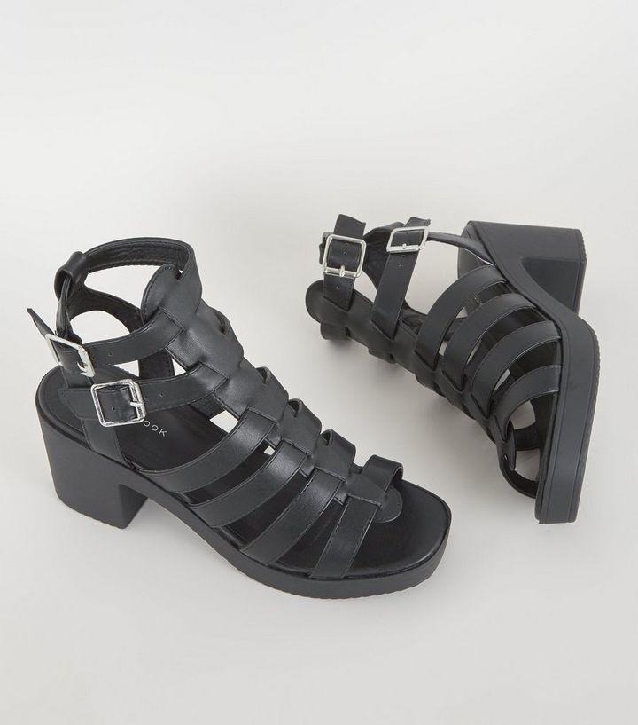 c56584fbac4 ... Black Leather-Look Chunky Gladiator Sandals. ×. ×. ×. Shop the look
