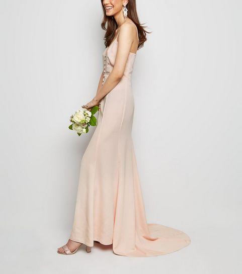 46f783c94a9b9 ... Robe longue rose pâle en satin boutonnée à l avant ...