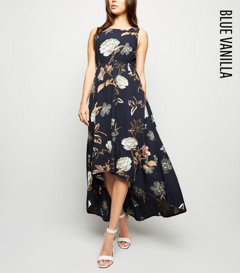 09a208e159ac ... Blue Vanilla Navy Floral Dip Hem Dress ...