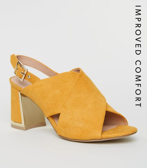 12204ab8d46 ... Mustard Cross Strap Metal Trim Heels ...