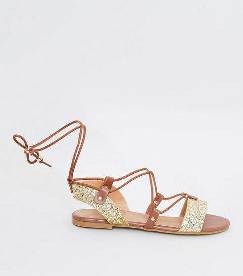 399679ed2a31 ... Gold Glitter Ankle Tie Ghillie Flat Sandals ...