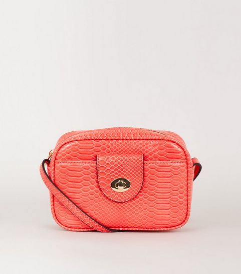 4f10f6d47140 ... Coral Faux Snake Camera Bag ...