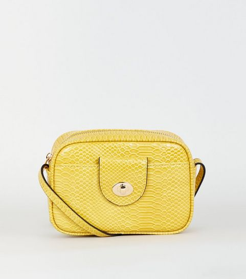9b6229dd09d4 ... Mustard Faux Snake Camera Bag ...