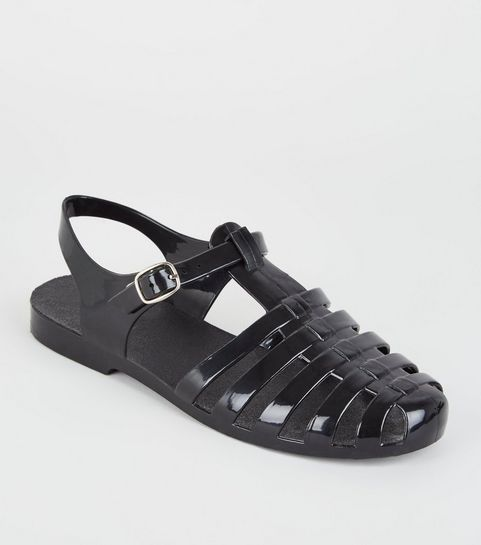 ae6931c17f5a ... Girls Black Caged T-Bar Jelly Sandals ...