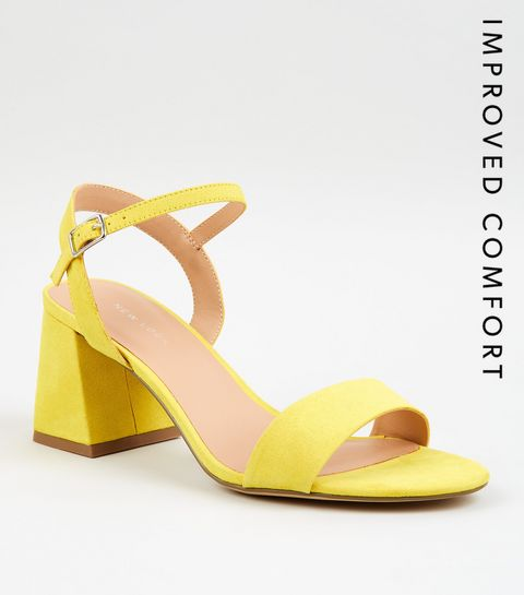 7e10b7c9ecaa ... Yellow Suedette Flared Low Block Heels ...