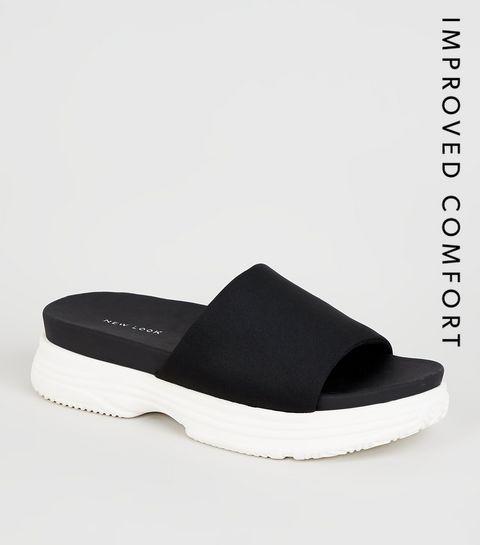 7117530ff411d6 ... Sandales de sport noires à assise plantaire et semelle compensée ...