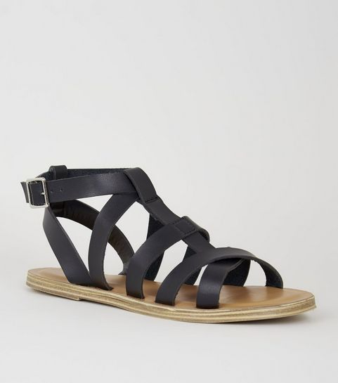 a415ff5a210 ... Girls Black Leather-Look Gladiator Sandals ...