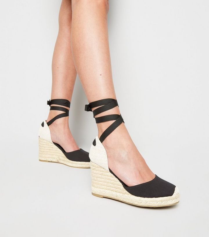 ee9d0731ca53 ... Black Ribbon Ankle Tie Espadrille Wedges. ×. ×. ×. Shop the look