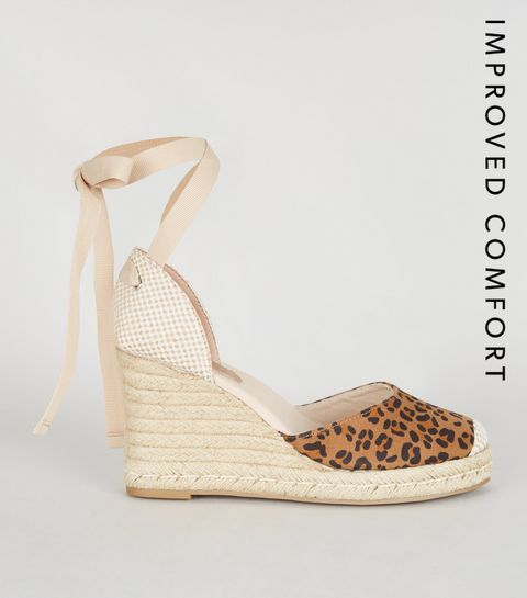 76b14e75e ... Stone Leopard Print Woven Wedge heels ...