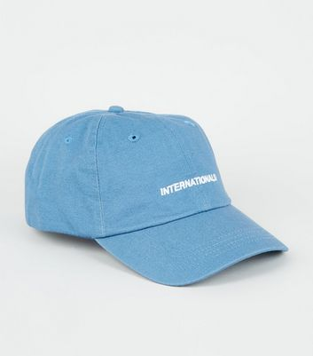 Pale Blue International Embroidered Slogan Cap