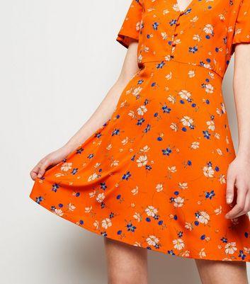Robe orange à imprimé petites fleurs Ajouter à la Wishlist Supprimer de la Wishlist