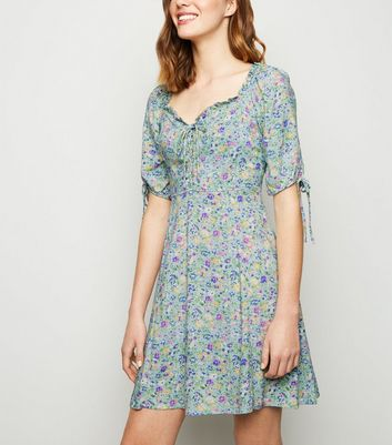 2b24fb15a0 Green Ditsy Floral Lace Up Milkmaid Dress New Look - New Look at Westquay -  Shop Online
