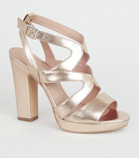 3affdd9326f ... Sandales couleur or rose à talons blocs et plateformes ...