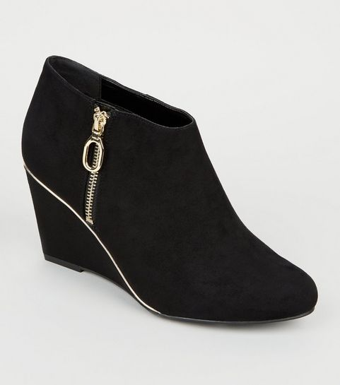 9e5bf2257c92 ... Wide Fit Black Gold Trim Wedge Ankle Boots ...