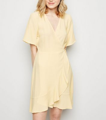 Pale Yellow Ruffle Hem Wrap Mini Dress