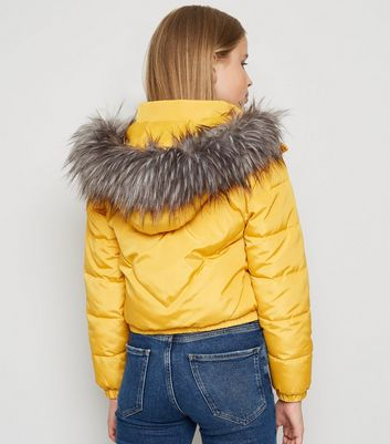 girls mustard faux fur hood puffer jacket new look