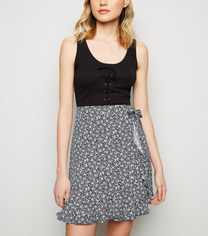 4626b62d4fa6 ... Black Ditsy Floral Wrap Front Mini Skirt. ×. ×. ×. Shop the look