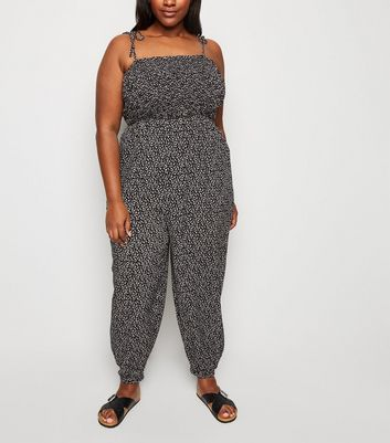 Curves Black Ditsy Floral Cuffed Jumpsuit