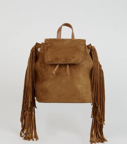 6516bff1e6 ... Tan Suedette Stud and Fringe Trim Backpack ...