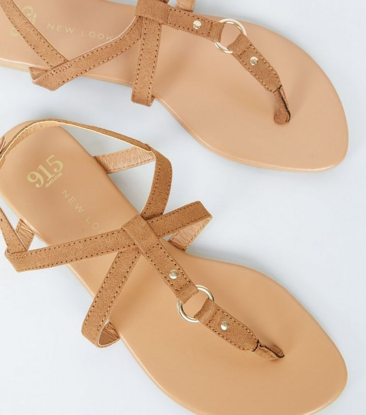 1642833088 ... Girls Tan Leather-Look Strappy Sandals. ×. ×. ×. Shop the look