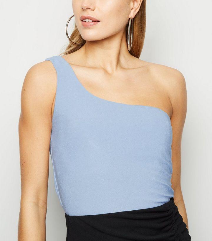 5d1e3c57c79c76 Pale Blue Glitter One Shoulder Crop Top