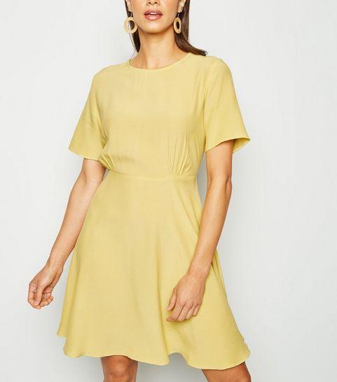 945541717d0 ... Yellow Round Neck Tea Dress ...