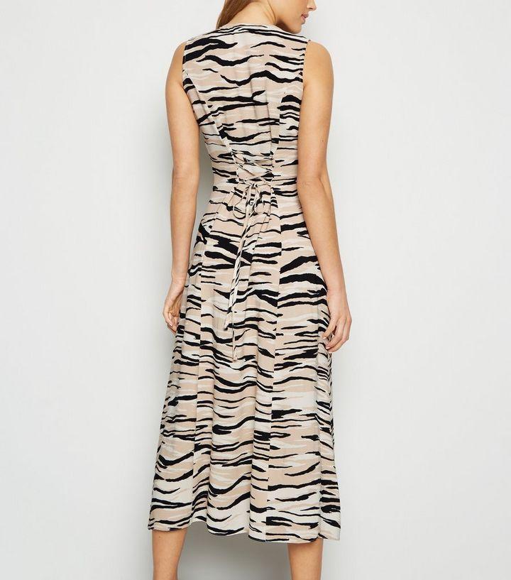 778affc6af898 ... Brown Zebra Print Sleeveless Button Up Midi Dress. ×. ×. ×. Shop the  look