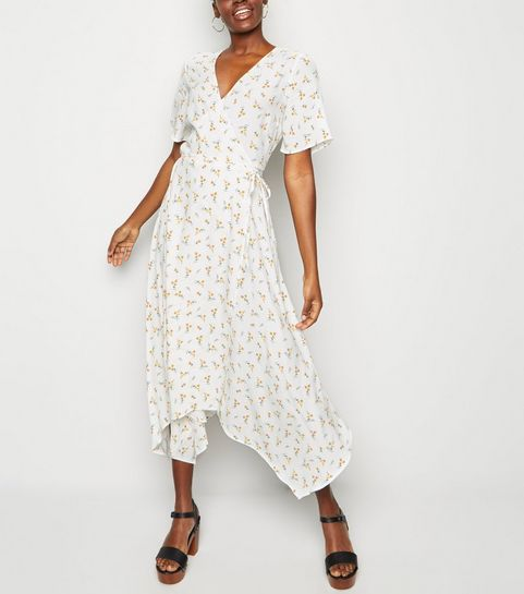 feb35f029503 ... White Ditsy Floral Hanky Hem Wrap Midi Dress ...
