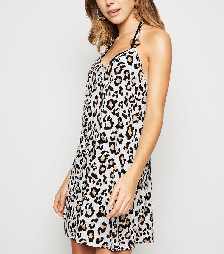 b9fa05bba69 White Leopard Print Swing Beach Dress