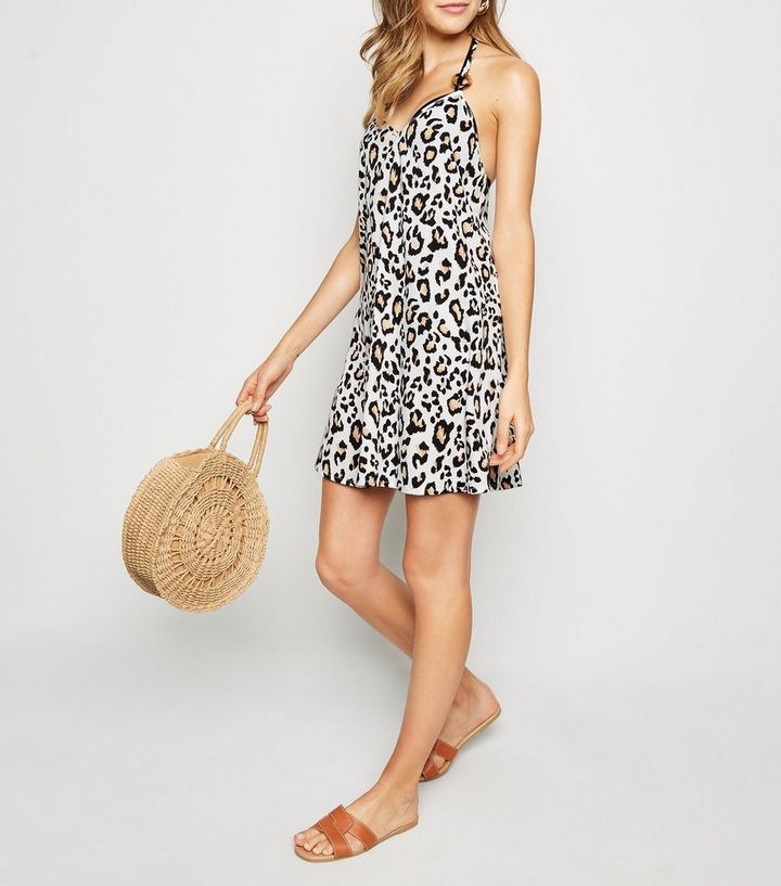 508b5b5d0c047 ... White Leopard Print Swing Beach Dress. ×. ×. ×. Shop the look
