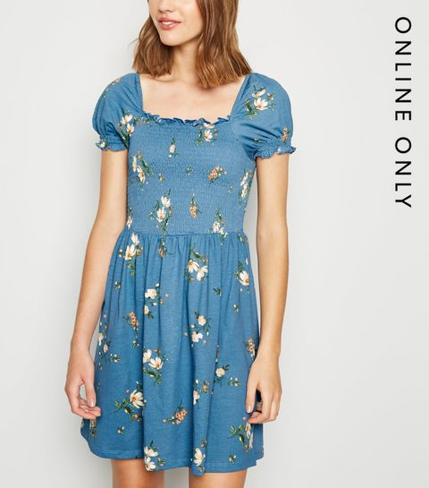 92a171b542eb ... Blue Floral Shirred Milkmaid Dress ...