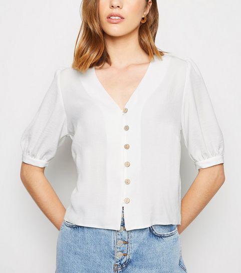 1444a84338a ... Chemise blanc cassé boutonnée à manches bouffantes ...