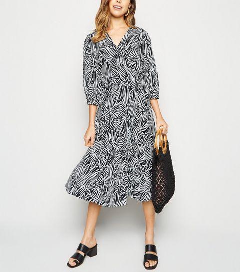 616bf5ab6e2 ... Black Zebra Print Puff Sleeve Midi Wrap Dress ...