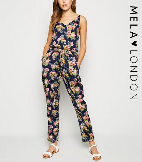 8e8db9d225c Mela Blue Floral Drawstring Jumpsuit · Mela Blue Floral Drawstring Jumpsuit  ...