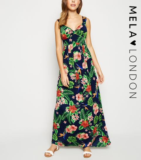 01c7affb47 ... Mela Navy Tropical Floral Maxi Dress ...
